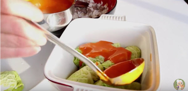 N cabbage rolls sauce pouring on 1